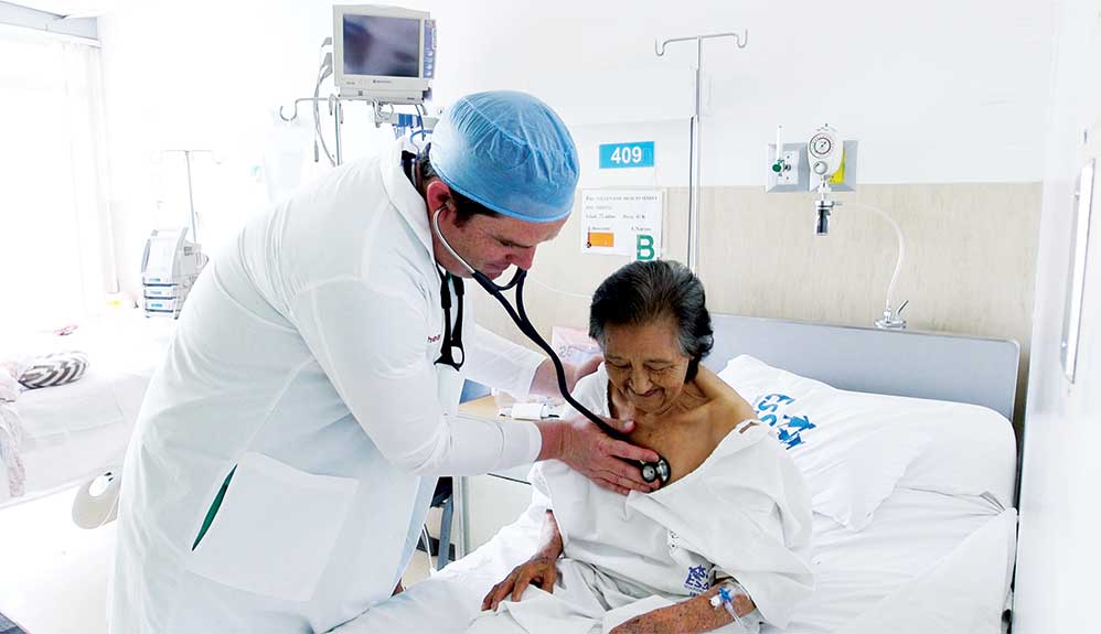 Doctor listening to patient's heart